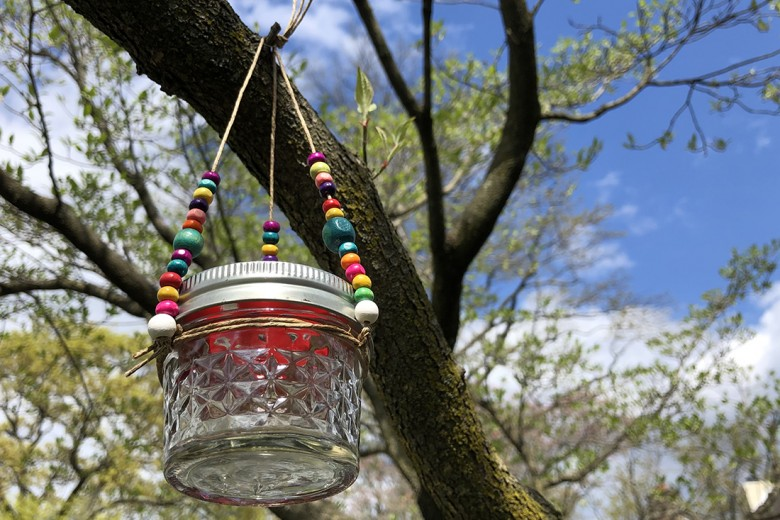 DIY Hummingbird Feeder hanging in a tree