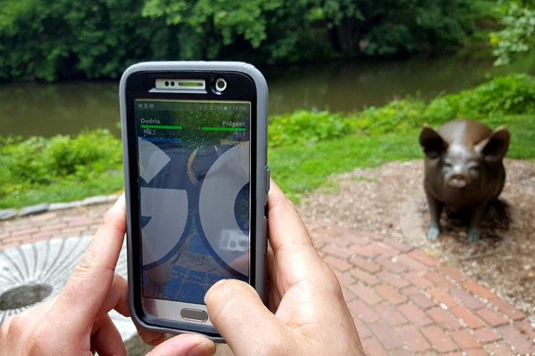 Playing Pokemon GO by the Brandywine River