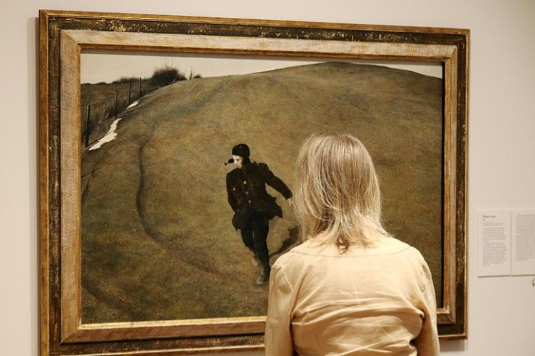 Woman viewing Winter, 1946 by Andrew Wyeth