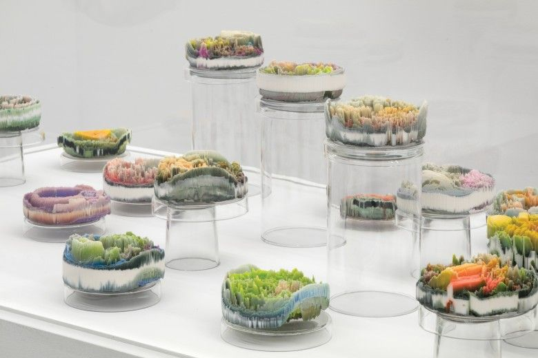 """Suzanne Anker, Remote Sensing: Micro-Landscapes (detail), 2013–17, plaster, pigment, resin in 24 Petri dishes, each 4 x 4 x 2"""". Courtesy of the artist."""