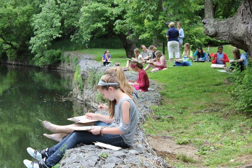 teens sketching along the Brandywine Creek