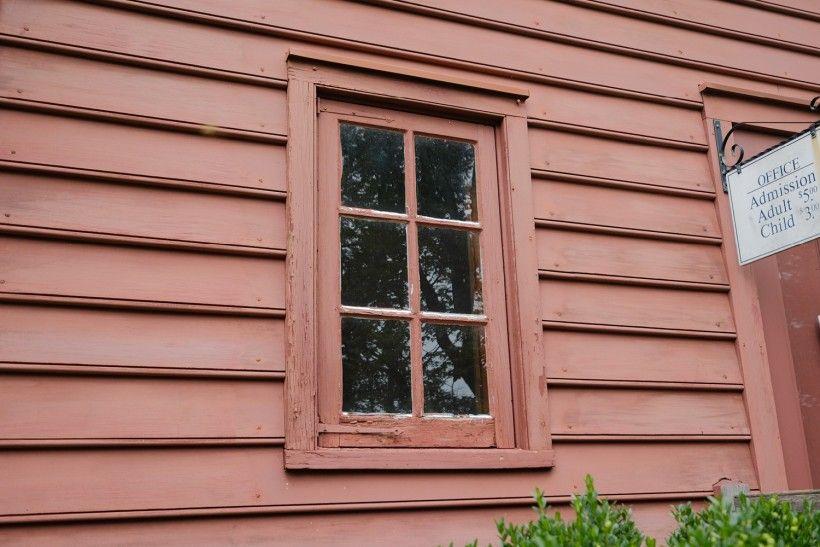 BEFORE photo of wood window restoration. Photo Credit: John Milner Architects, Inc.