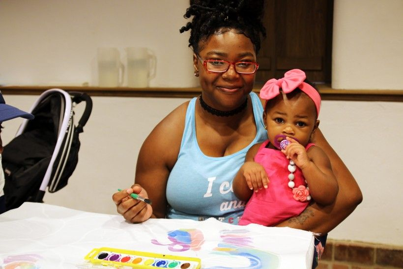 A woman and a baby enjoy arts & craft activities at the Brandywine River Museum of Art