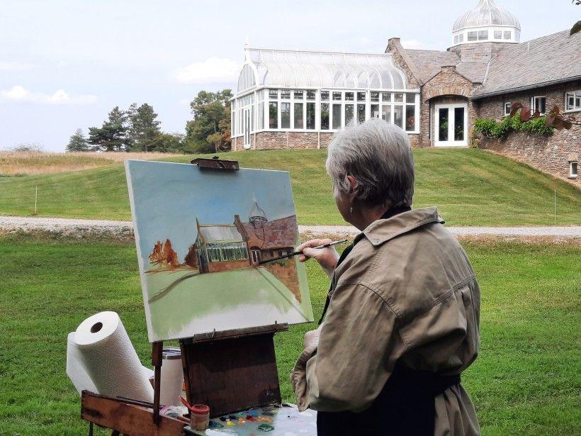 Artist Patricia Dickun painting Penguin Court's Conservatory