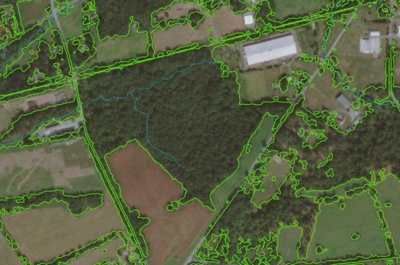 Recently acquired remote sensing data allows for accurate woodland delineation as shown by the green outline in this image.