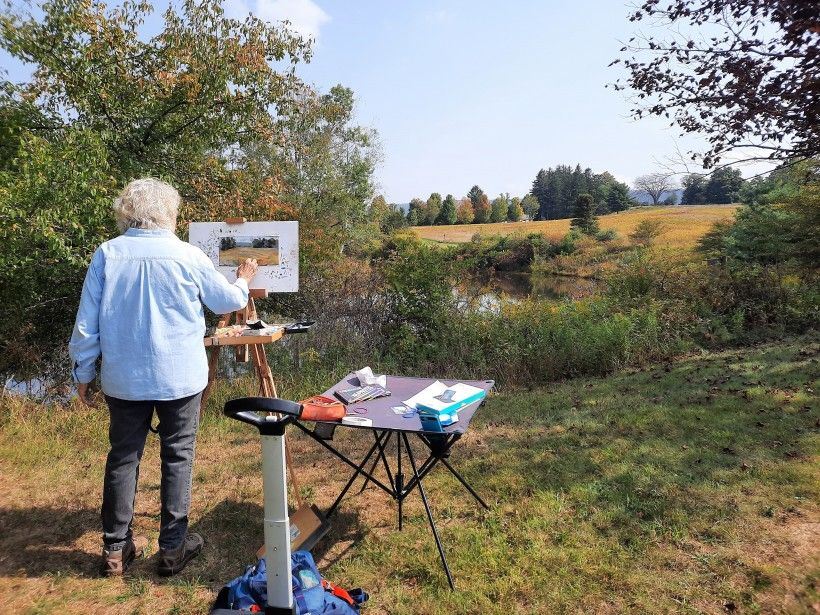 Artist Nan Houette painting at the pond at Penguin Court