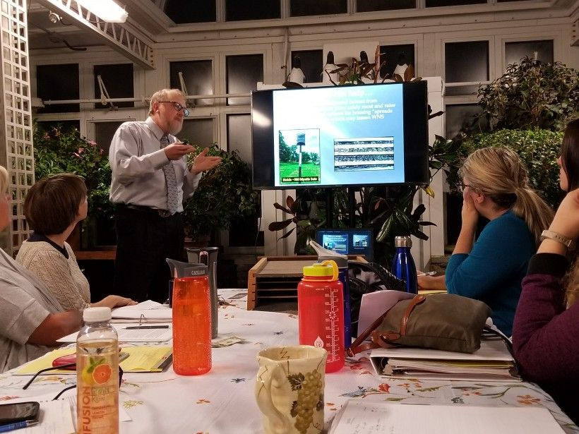 PMN participant Scott Jones delivers his Capstone Project presentation, which proposes adding bat boxes around the pond at Penguin Court.