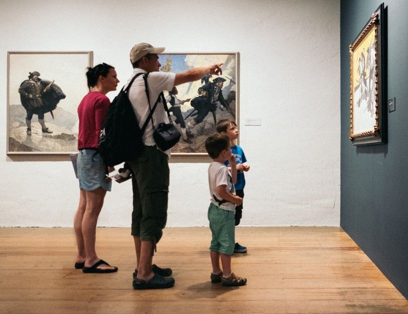 family of four looking at paintings in the N. C. Wyeth gallery