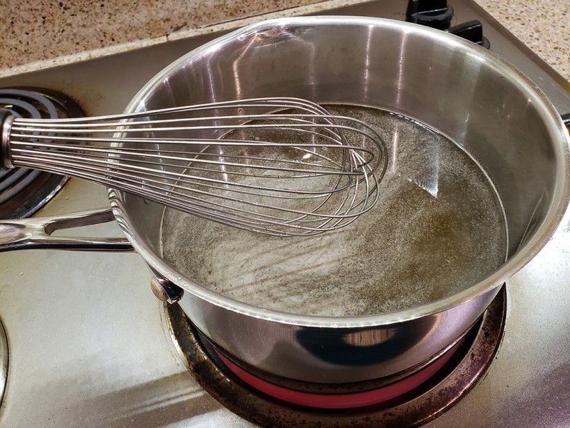 Cooking the dandelion simple syrup in a pot