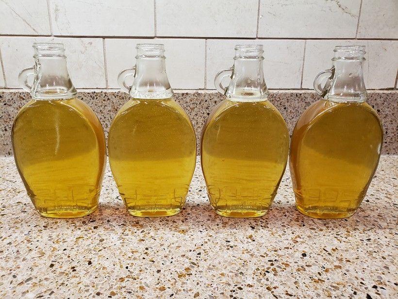 Dandelion simple syrup in glass jars