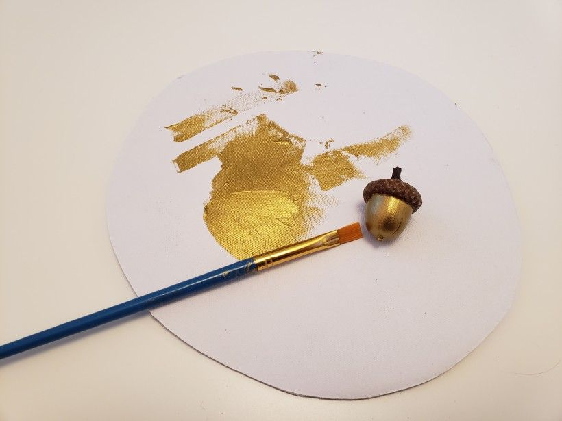 painting acorns with gold paint