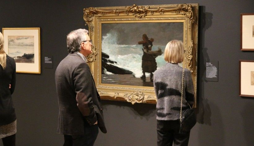 members looking at artwork