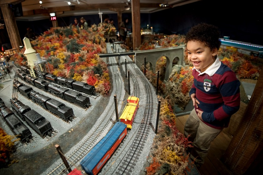Boy with Brandywine Christmas train display
