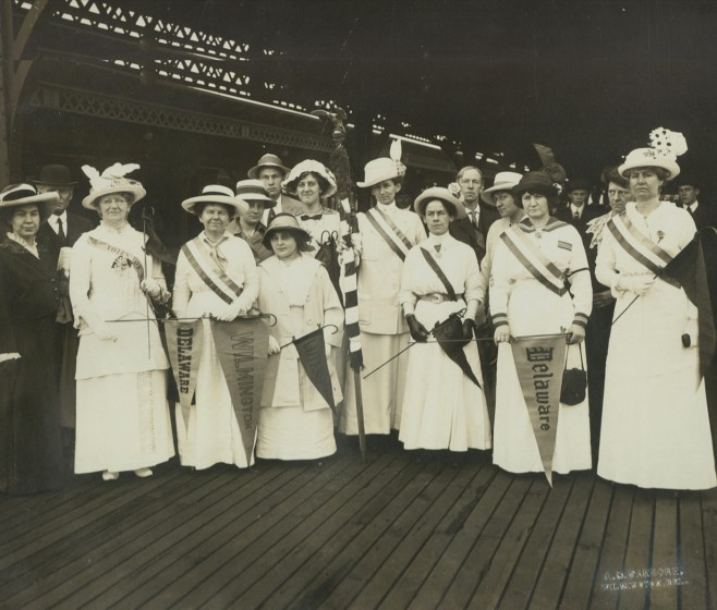 A group of women at the Wilmington train station departing for a suffrage demonstration in Washington, D. C., May 9, 1914. Courtesy of the Delaware Historical Society.